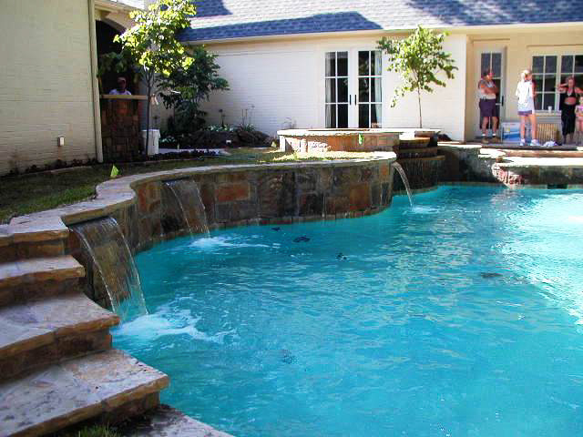 Retaining Wall Pool Ideas pros matching capstone over brick steps and wall cons overhang might cause problems for Retaining Walls Image 4 Dallas Texas Retaining Walls Construction